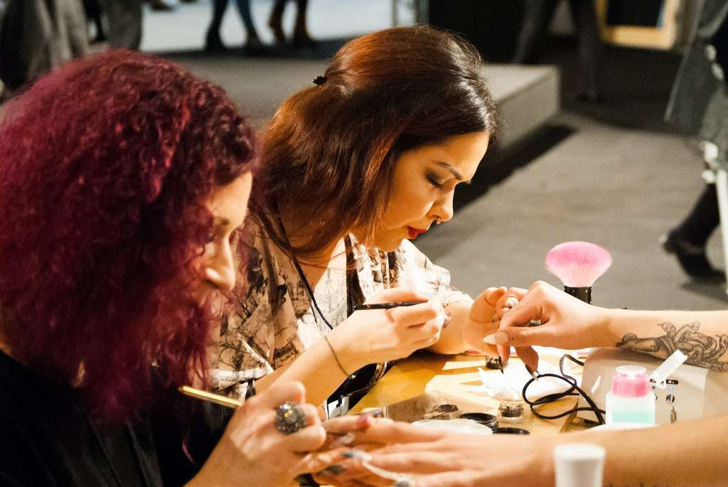 Nail Technician Giving a Manicure