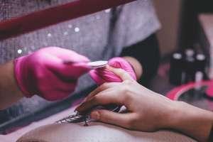 Nail Technician Caring for Client Fingernails