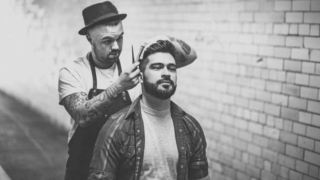 Hairstyling Student Learning how to Barber
