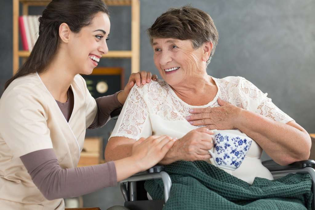 Personal Support Worker caring for client