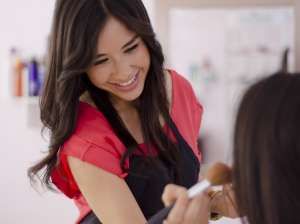 National Institute Beauty School Student Learning Makeup Application