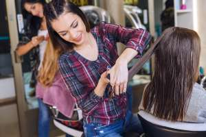 National Institute Hairstylist Student Learning to Cut Hair